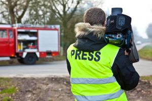 Fire-fighting-training-man-with-camera-min