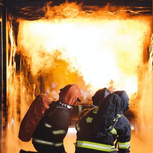 fire-fighting-training-3-firemen-on-knees-hose-min